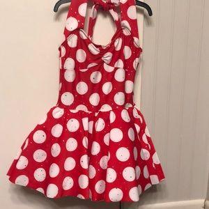 Red polka dot dance costume.